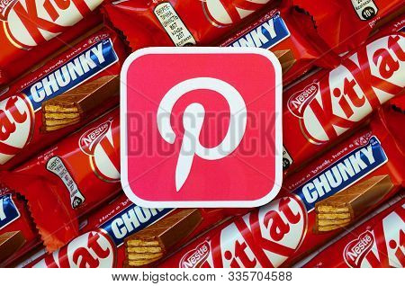 Pinterest Paper Logo On Many Kit Kat Chocolate Covered Wafer Bars In Red Wrapping. Advertising Choco