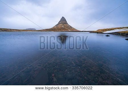 Famous Mountain With Waterfalls In Iceland,  Kirkjufell, Winter In Iceland, Ice And Snow, Reflection