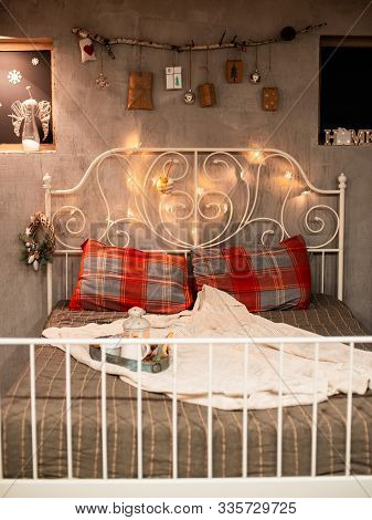 Christmas Bedroom Decoration In Loft Style, Concrete Gray And Stick With Gifts Hanging On The Wall.