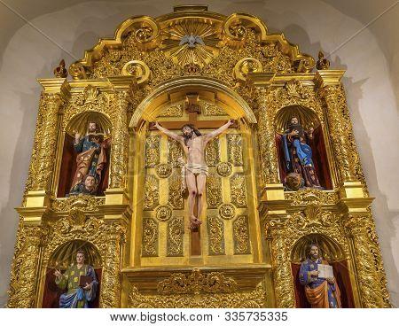 San Antonio, Texas - October 6, 2019 Golden Basilica Altar Jesus Christ Crucifixion Mark, Matthew, L