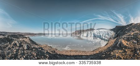 Panoramic Image Of Eqip Sermia, Eqi Glacier In Greenland Disko Bay. Boat Trip In The Morning Over Th