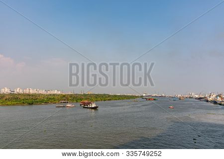 Ho Chi Minh City, Vietnam - March 13, 2019: Looking Downriver At Sunset On  Gray-blue Song Sai Gon R