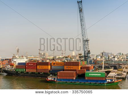 Ho Chi Minh City, Vietnam - March 13, 2019: Tan Thuan Port On Song Sai Gon River At Sunset. Tall Cra