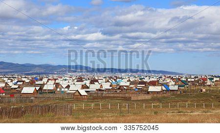 Small Wooden Huts At The Suburbs Of Siberian City Ulan-ude, Buryatia, Russia.
