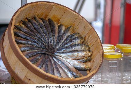 Freshly Salted Sardines In A Round Wooden Box