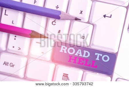 Conceptual hand writing showing Road To Hell. Business photo showcasing Extremely dangerous passageway Dark Ri Unsafe travel White pc keyboard with note paper above the white background. poster
