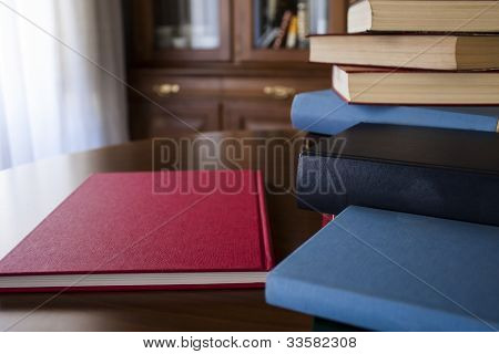Many different sized colored and shaped books
