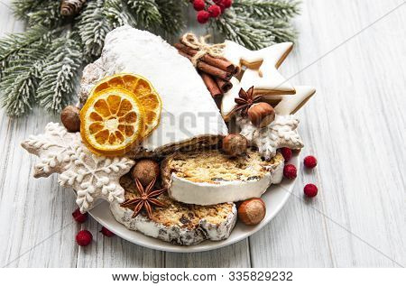 Christmas Stollen On Wooden Background. Traditional Christmas Festive Pastry Dessert. Stollen For Ch
