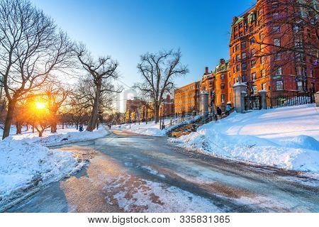 View on Boston public garden at winter sunset