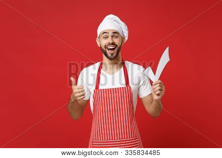 Excited Young Male Chef Cook Or Baker Man In Striped Apron White T-shirt Toque Chefs Hat Isolated On
