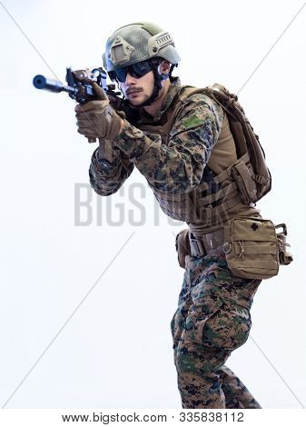 modern warfare american marines soldier aiming  on laseer sight optics  in combat position and searching for target isolated on white background