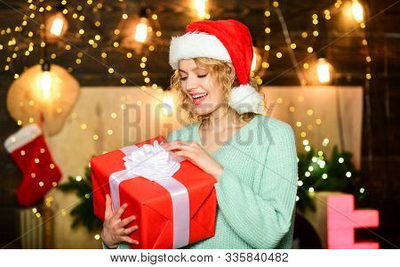 Woman Hold Gift Box Christmas Decorations Background. Christmas Is By Far Most Awaited For Holiday O
