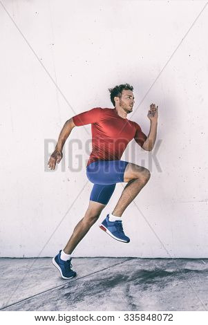 Run athlete runner man running jumping explosive dynamic stretching plyo workout training glutes and body muscles for hiit exercise.