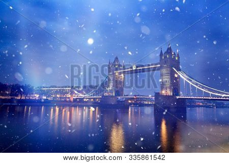 Christmas in London concept: Tower Bridge during night time with snowfall