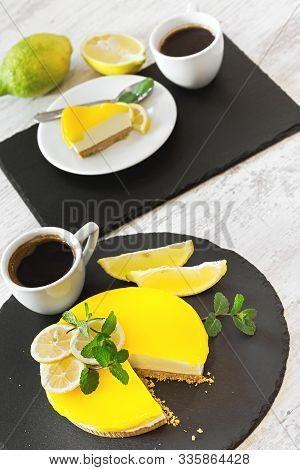 Delicious Lemon Cheesecake And Cup Of Fresh Coffee On Rustic Table