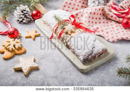 Stollen A Traditional European Cake With Nuts And Candied Fruit, Is Dusted With Icing Sugar And Cut