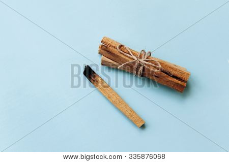 Palo Santo Sticks On A Blue Background. They Are Used In Aromatherapy And Religious Rites And Medita