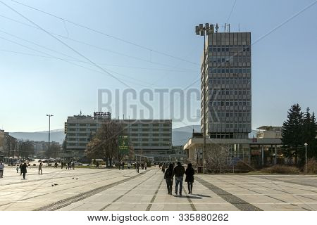 Pernik, Bulgaria - March 12, 2014:  Typical Building And Street At The Center Of Town Of Pernik, Bul