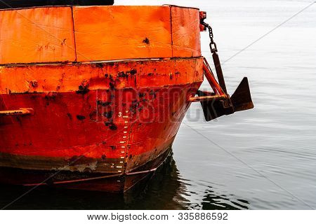 Close-up Of Prow Of Old Rusty Red Ship Moored In Harbour
