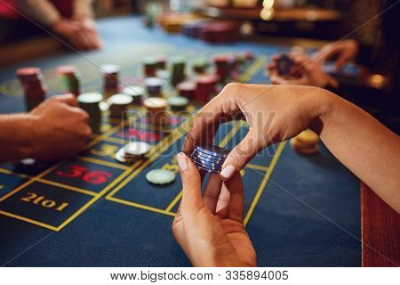 Gamer Play Casino Roulette At A Table In A Casino. Betting Gambling Poker Roulette Background Concep
