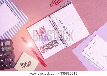 Handwriting text Lay The Groundwork. Concept meaning Preparing the Basics or Foundation for something Striped paperboard notebook cardboard office study supplies chart paper. poster