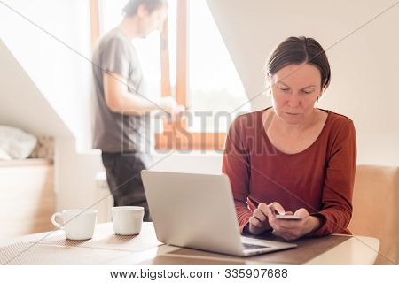 Couple Telecommuting, Woman And Man Working In Home Office, Selective Focus