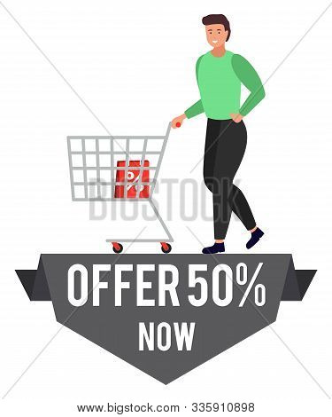 Promotional Banner Of Special Offer With Half Reduction Of Price. Man Walking With Trolley Loaded Wi