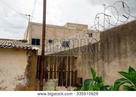 Planaltina, Goiás, Brazil-november 23, 2019: Barbwire Sitting On Top Of A Tall Fence For Extra Prote