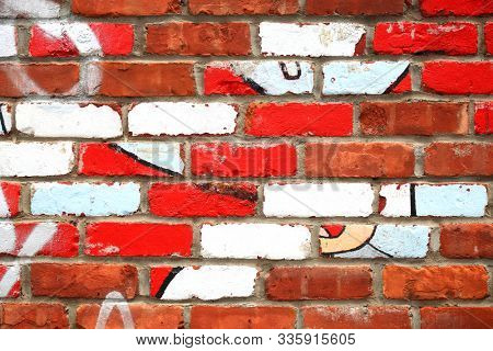 Mat brick wall paint with white and red and old graffiti