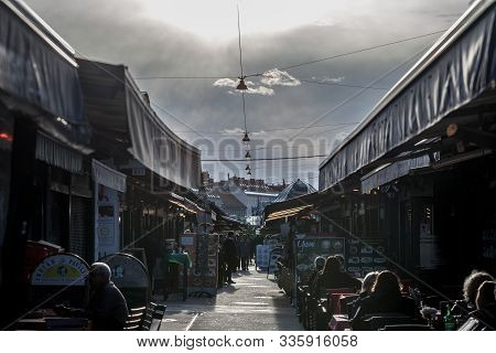 Vienna, Austria - November 6, 2019: Main Alley Of The Wien Naschmarkt, With Terraces Of Cafes And Re