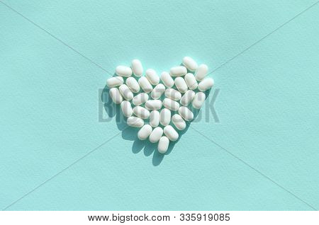 Heart Of Tic Tac Hard Mints Close Up. Tic Tac Is Popular Due Its Minty Fresh Taste And Easy To Carry