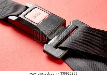 Fastened Seat Belt On Red Background With Copy Space, Close-up