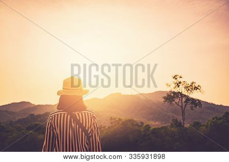 Copy Space Of Silhouette Woman Looking View On Top Of Mountain And Sunset Sky Abstract Background. F