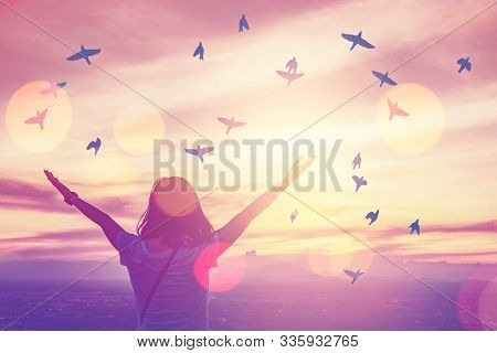 Copy Space Of Silhouette Woman Rise Hand Up On Top Of Mountain And Sunset Sky With Birds Fly Abstrac