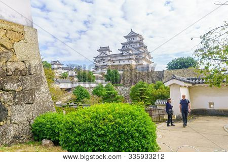 Himeji, Japan - October 14, 2019: View Of The Himeji Castle, Dated 1333, With Visitors, In The City