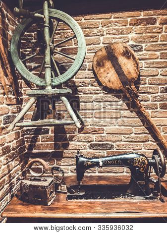Lviv, Ukraine - December 25, 2018: Old Loom, Sewing Machine. Accessories For Sewing. Ancient Things