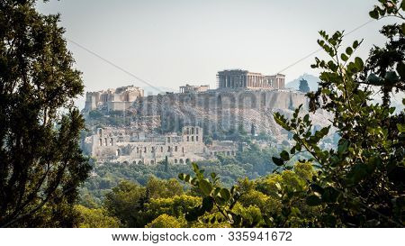 The Acropolis And Parthenon Framed By Trees And Herodes Theater As Viewed From Filippapis Hill