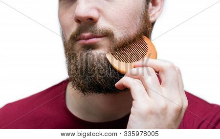 Young Man Portrait With Comb His Beard And Moustache On White Isolated Background