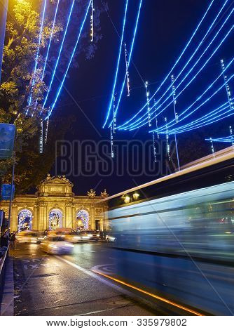 Alcala Gate Illuminated By Christmas Lights. Madrid, Spain.