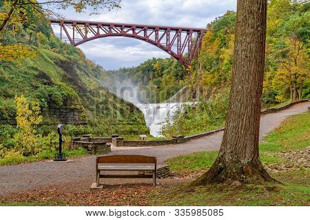 Upper Falls And Genesee Arch Bridge At Letchworth State Park In New York