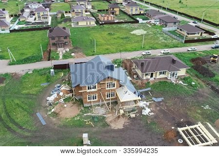 House With A New Roof Made Of Metal, Holiday Village, View From Above. Village In Spring From Above,