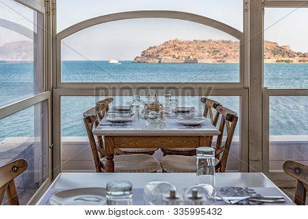Plaka, Crete - October 16, 2019: View Of Spinalonga Island From Tavern On Crete, Greece.