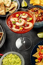 Mexican Food, Many Dishes Of The Cuisine Of Mexico On A Black Background. Shrimp Cocktail, Chili Con