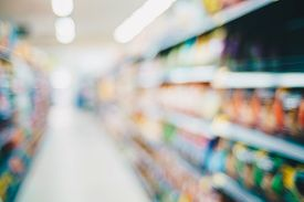 Abstract Blurred Row Of Goods On Shelf In Supermarket