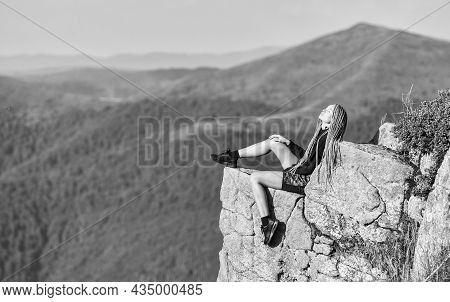 Leadership Concept. Rock Climbing Skill. Reaching The Top. Woman Relax On Mountain Cliff. Feel Freed