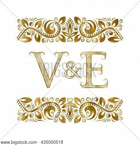 V And E Vintage Initials Logo Symbol. The Letters Are Surrounded By Ornamental Elements. Wedding Or
