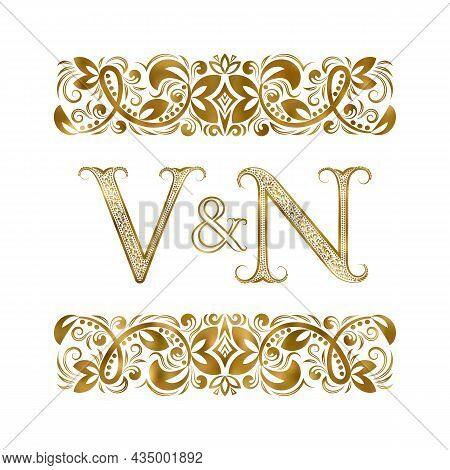V And N Vintage Initials Logo Symbol. The Letters Are Surrounded By Ornamental Elements. Wedding Or