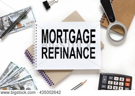 Mortgage Refinance. Notepad With Place For Text Near Money Bills. White Background.