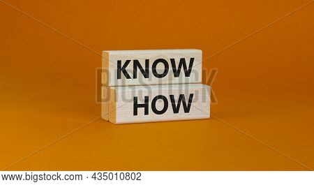 Know How Symbol. Concept Words 'know How' On Wooden Blocks On A Beautiful Orange Background. Busines