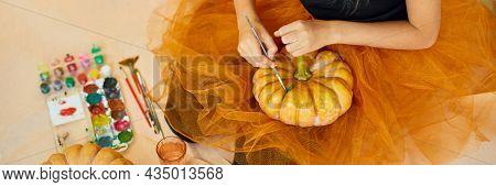 Banner Little Girl Drawing Face On Orange Halloween Jack-o-lantern Pumpkin